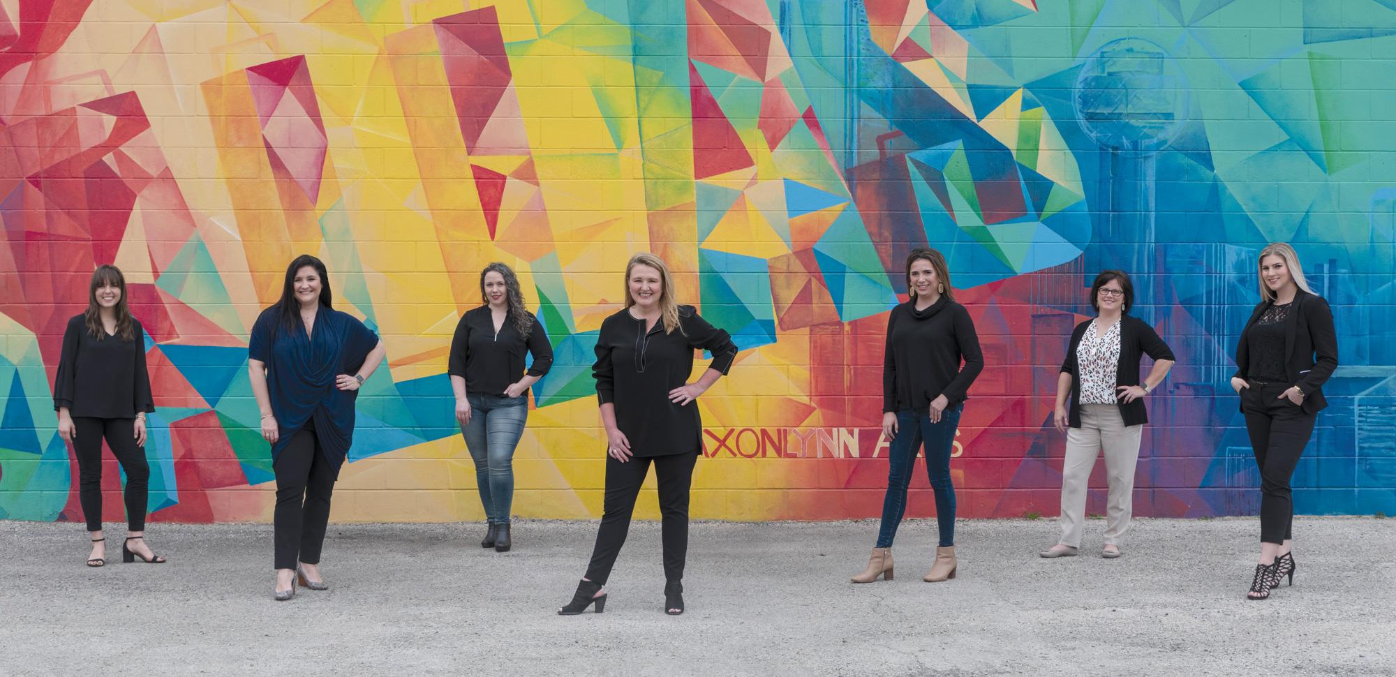 DMA Solutions' Management Team (from left to right) Jessica Schneider, Megan Zweig, Leslie Loris, Dan'l Mackey Almy, Marissa Baurys, Marci Allen, and Mackenzie Wortham