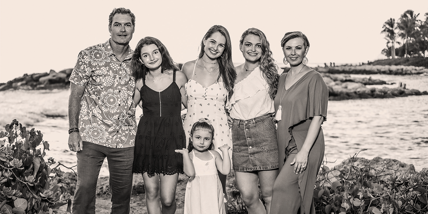 When Veronica was diagnosed, Trent spontaneously packed up the family and went to Oahu, Hawai'i, for five weeks to make those precious moments count. Valentina (5) holds up Trent, Marin (15), Hannah (21), Allyson (18), and Veronica during their trip in June 2018, five months prior to his wife's passing