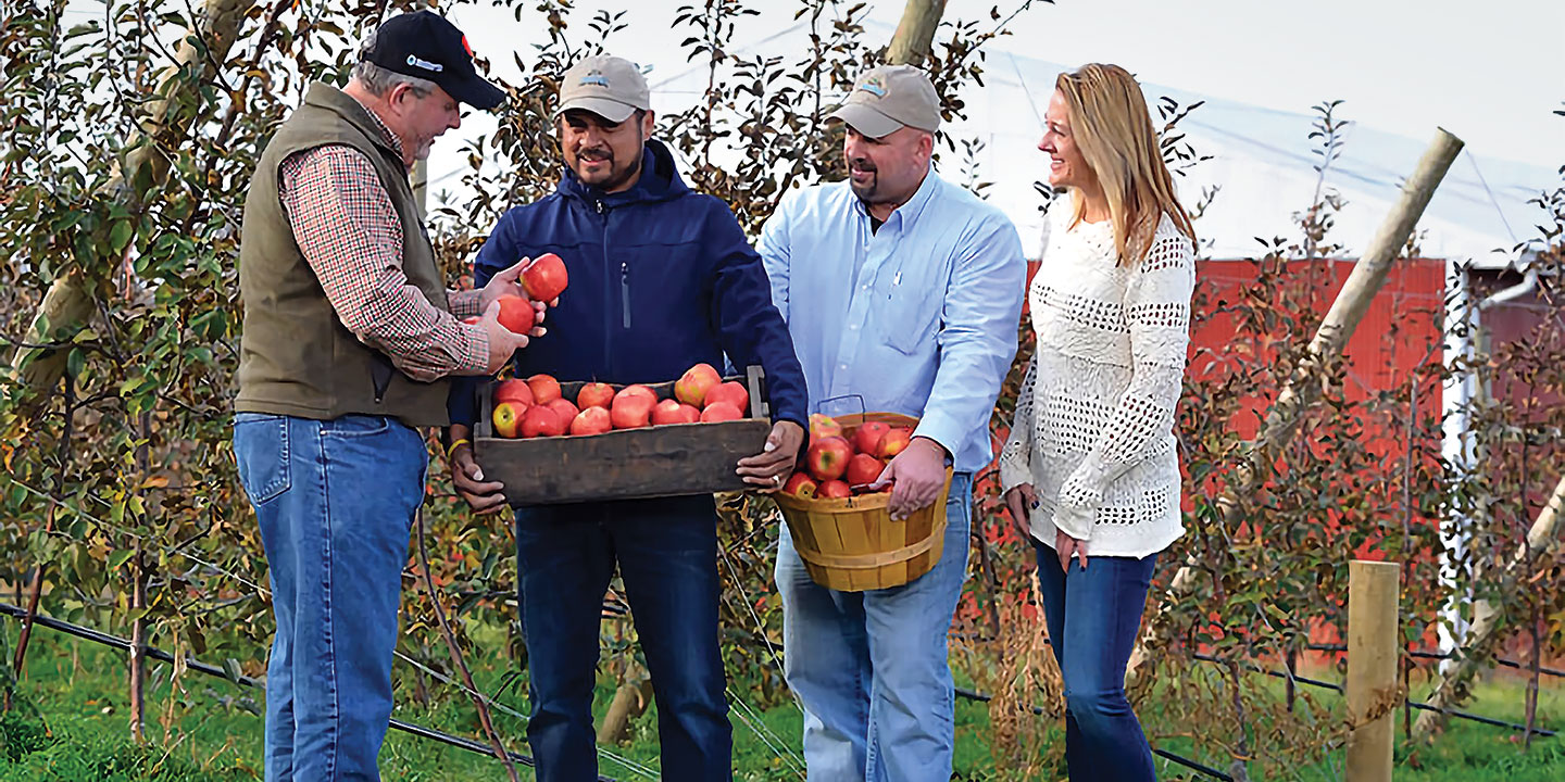 Co-Owners Rod Farrow, Jose Iniguez, and Jason Woodworth of Lamont Fruit Farm/Fish Creek Orchard with New York Apple Sales President and Owner Kaari Stannard