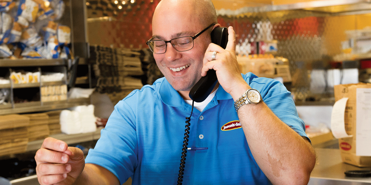 Managing Partner John Riley operating the phones at one of Jason's Deli's 280 locations
