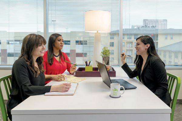 (From left to right) Jessica Schneider, Mariah Demery, and Vanessa Jimenez discuss strategy