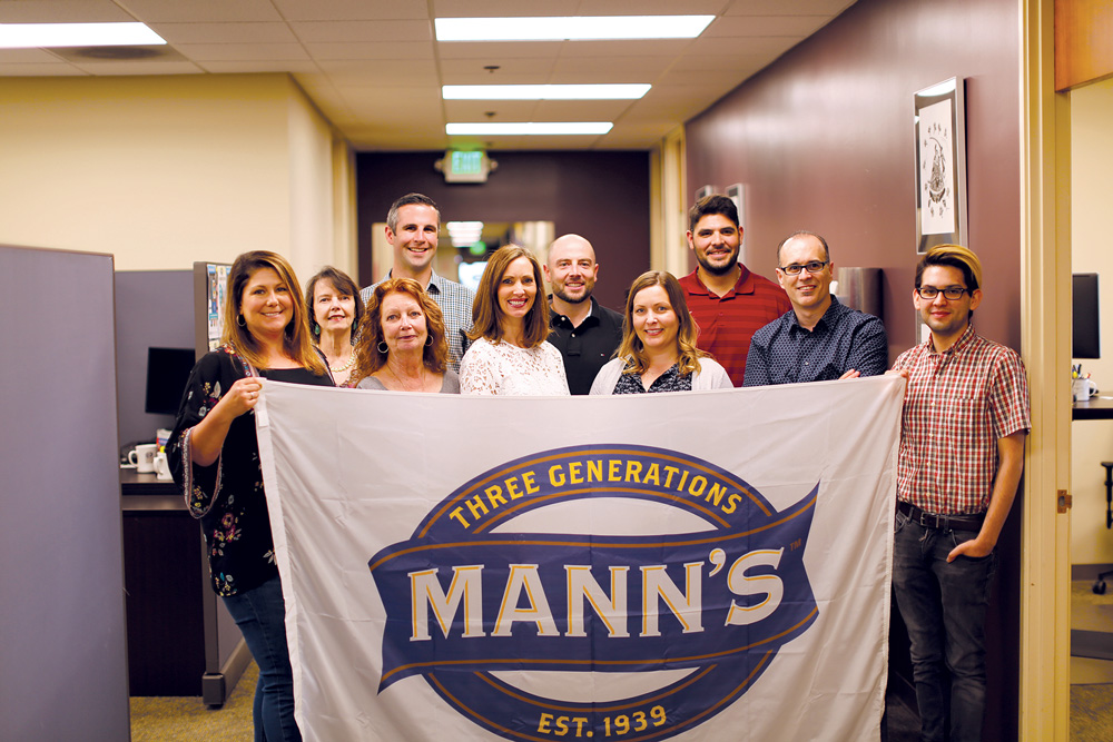 The Mann Packing Team at the company's headquarters in Salinas, California. From left to right: Gina Nucci, Sharon Outland, Susan Cameron, Alex McClosky, Loree Dowse, Jacob  Shafer, Jennifer Lind, Gabe Gonzales, Roberto Avila, and Kane Palacios