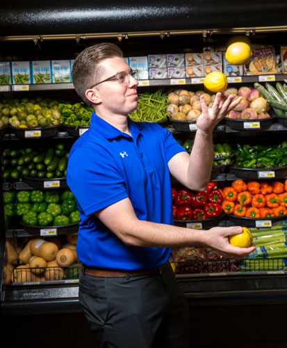 Josh Rector, Produce Category Manager, has a knack for not only managing produce, but juggling it
