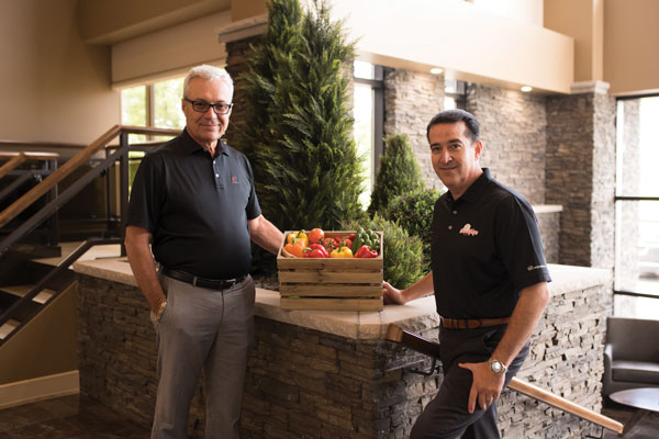 (left) Jim Dimenna, President, and (right) Carlos Visconti, CEO of Red Sun Farms USA and Canada, at the Red Sun Farms HQ in Kingsville, Ontario