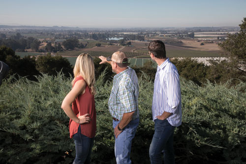 Kiersten Sambrailo Clontz, Mark Sambrailo, and Erik Sambrailo overlooking the Pajaro Valley