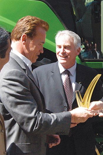 Joe Pezzini, the first LGMA Chairman, presents Arnold Schwarzenegger with an award in 2009
