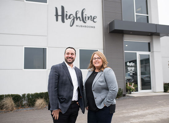 Aaron Hamer and Jane Rhyno outside Highline Mushrooms headquarters in Leamington, Ontario