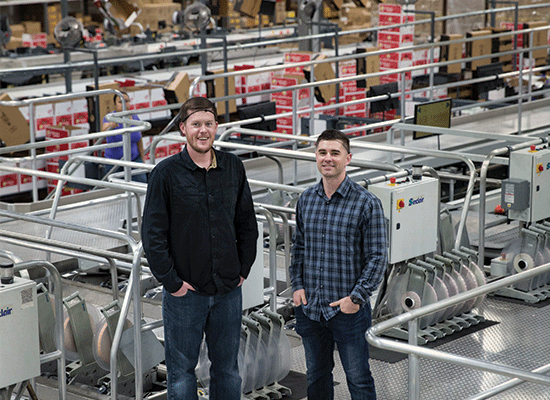 Tyler Weinbender and Alex Fickes, Warehouse Operations Manager, in one of Superfresh Growers' sustainable packing facilities