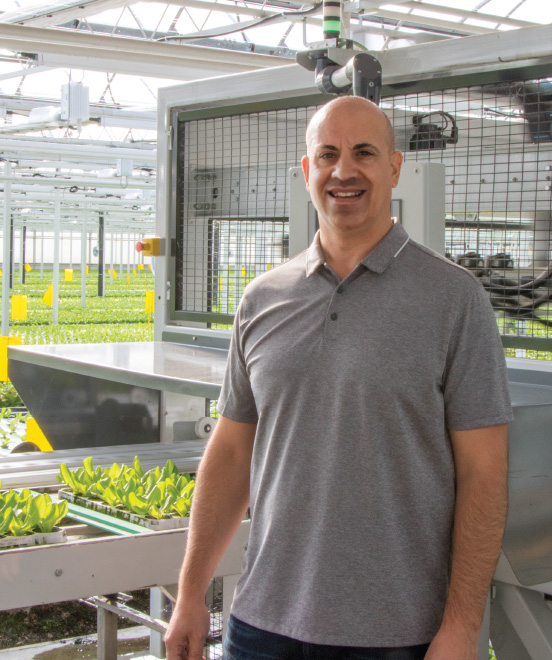 Gianni Mucci, Vice President of Operations, with Mucci Farms' Lettuce Automation Machine