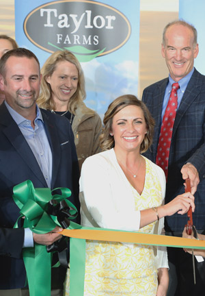 Director of Sales CJ Given, Director of Sustainability Nicole Flewell, and Founder and CEO Bruce Taylor at the ribbon cutting ceremony celebrating Taylor Farms' Gonzales, California,  facility's TRUE Platinium Certification