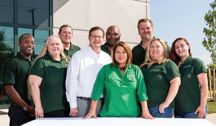 Steve Marinello (centered left) and Mayda Sotomayor-Kirk (centered right) with the Greenyard Logistics USA team