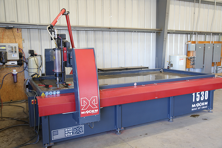 Water jet cutting apparatus used in the Ramsay Highlander shop for precision making of parts